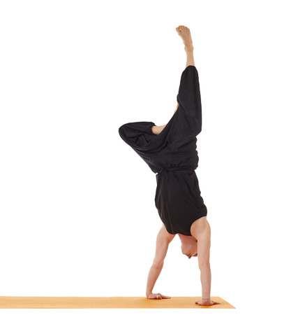 handstand: Flexible yoga man doing handstand, isolated on white
