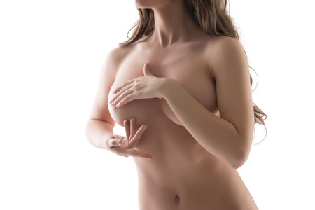 nude breast: Concept of mastitis. Naked woman doing breast palpation, isolated on white Stock Photo
