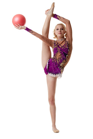 graceful: Free callisthenics. Graceful blonde dancing with ball, isolated on white