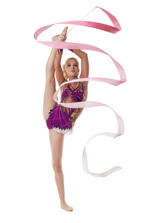 rhythmic gymnastics: Image of charming artistic gymnast dancing with pink ribbon Stock Photo