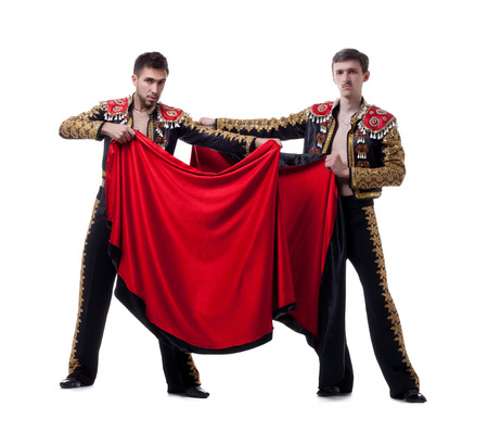 Image of funny men posing dressed as bullfighters