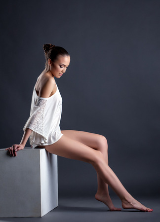 bared: Model posing in romantic blouse with bared shoulder Stock Photo