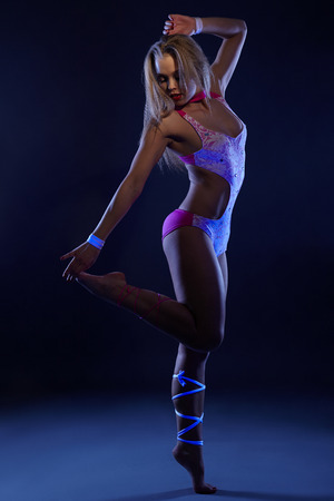 showgirl: Image of go-go showgirl posing at camera in UV light