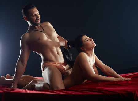 nude babe: Macho having passionate sex with his busty girlfriend Stock Photo