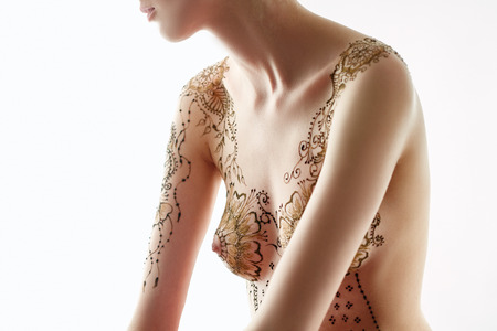 Beautiful topless model with henna patterns on her body, close-up Stock Photo