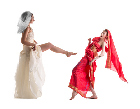sexy bride: Fighting of brides, isolated on white. Modern vs. Traditional