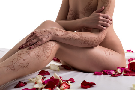 sexy women naked: Image of nude woman with henna patterns on body, close-up Stock Photo