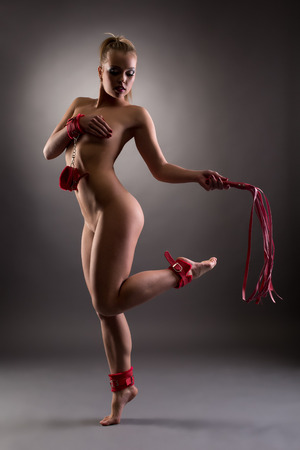 nude young girl: Studio shot of beautiful nude girl with BDSM attributes