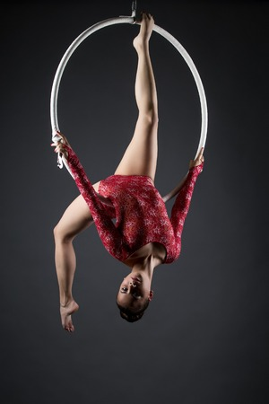 head down: Image of flexible young girl with hoop posing head down