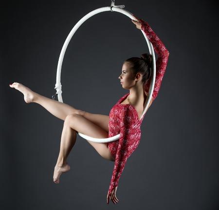 acrobat gymnast: Image of sexy acrobatic girl posing with hanging hoop Stock Photo