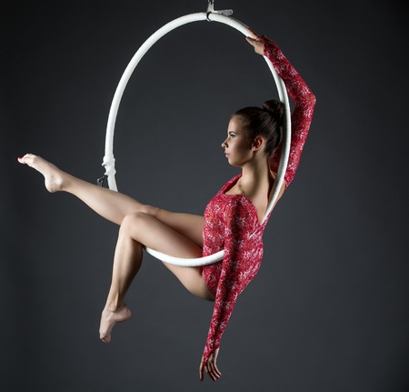Image of sexy acrobatic girl posing with hanging hoop Archivio Fotografico
