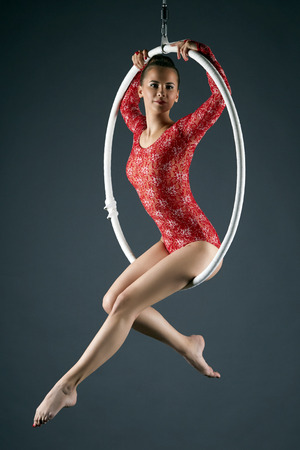 Image of attractive sexy girl posing on aerial hoop Stockfoto