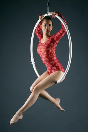 Image of attractive sexy girl posing on aerial hoop Archivio Fotografico