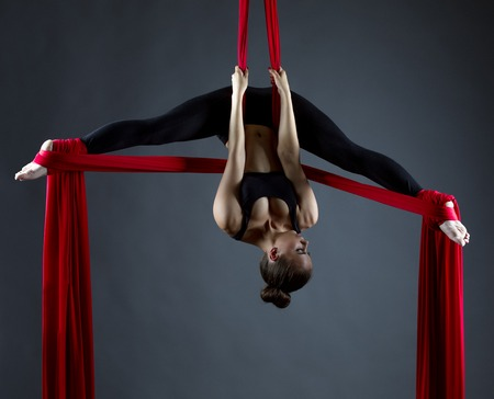 sexy dancer: Image of sexy female acrobat performs hanging upside down