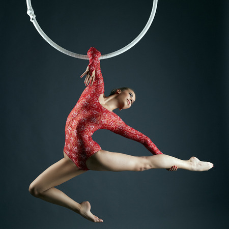 Studio shot of graceful female aerialist posing at camera 写真素材