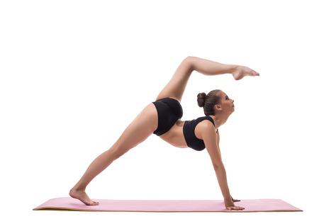harmonous: Yoga. Image of harmonous girl showing exercise, isolated on white
