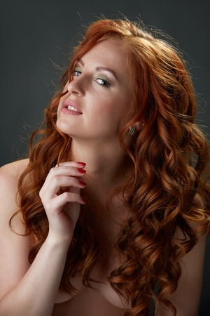 girls naked: Portrait of curly red-haired beauty posing nude to waist