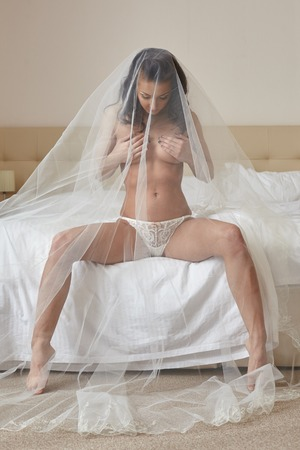 brunette naked: Image of sexy bride posing provocatively in hotel room