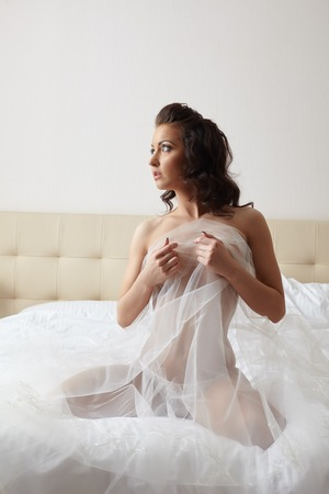 topless brunette: Image of beautiful bride posing topless hiding behind veil