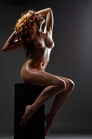 Image of hot red-haired beauty posing nude with wet body Stock Photo