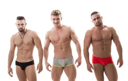 desnudo masculino: Foto de tres machista sexy con torsos desnudos, aislado en blanco