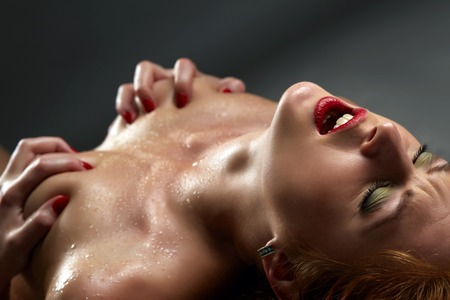 Concept of passion. Image of sensual woman has orgasm Stock Photo