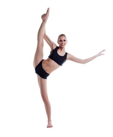 beautiful body: Smiling blonde woman posing doing vertical split Stock Photo