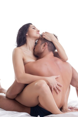 Passionate heterosexual couple making love, isolated on white