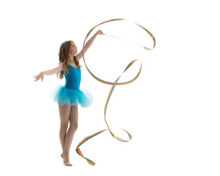 rhythmic gymnastics: Adorable little gymnast dancing with ribbon, isolated on white