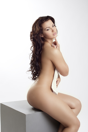 Bodycare concept. Sensual naked girl posing at camera