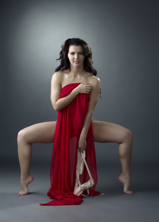 Image of attractive ballet dancer posing with red cloth photo