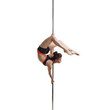 harmonous: Pole dance. Pretty girl posing gracefully curving, isolated on white