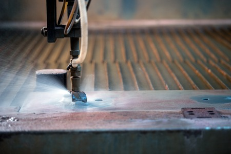 Image of effective method cutting metal - waterjet, close-up Stock Photo