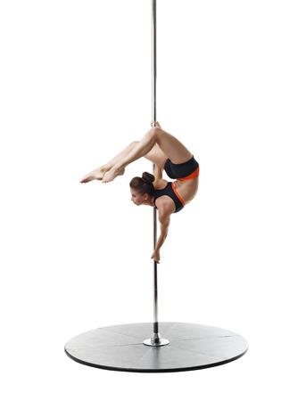 harmonous: Professional dancer on pylon. Studio photo, isolated over white background