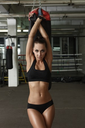 harmonous: Image of harmonous tanned brunette posing in gym