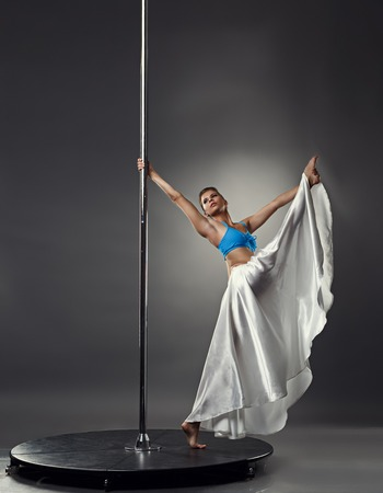 sexy dancer: Pole dance. Artistic dancer posing in difficult stretching pose