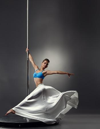sexy girl dance: Studio shot of beautiful graceful girl dancing on pole