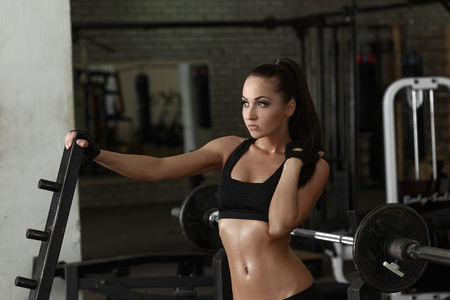 sweaty: Gym. Shot of beautiful brunette posing sweaty after workout Stock Photo