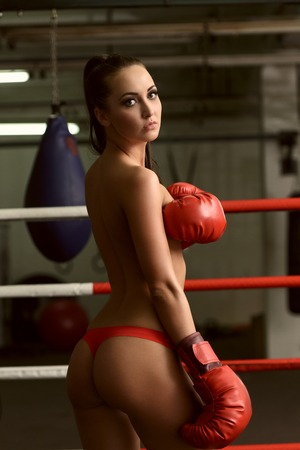 topless brunette: Image of beautiful topless brunette posing on boxing ring