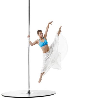 harmonous: Dancing on pylon. Graceful girl posing in vertical split