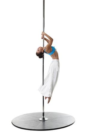 harmonous: Beautiful young girl dancing on pylon. Studio photo Stock Photo