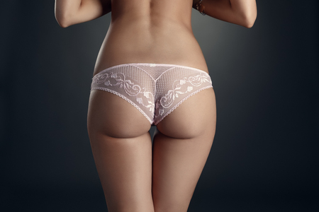 nude ass: Close-up of elastic womans ass in erotic lace panties