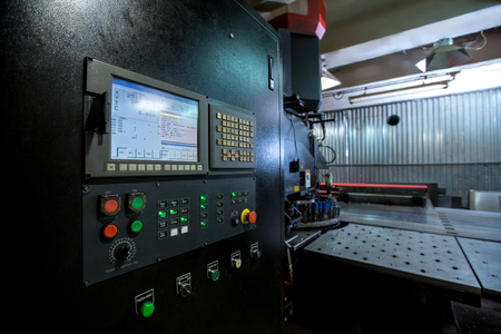 automatic machine: Punching machine. Foreground of monitor and control panel Stock Photo