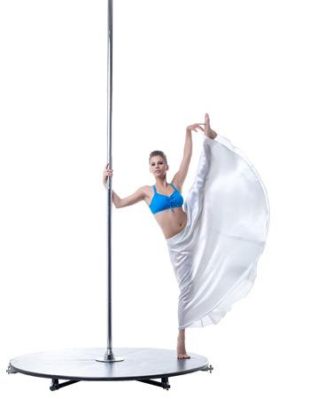 harmonous: Cute female dancer posing in vertical split on pylon
