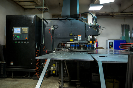 automatic machine: Production workshop. Modern machine for punching metal