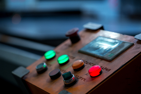 computerised: Image of red button lit on control panel, close-up