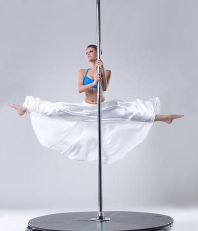 dance steps: Pretty woman easily performs complex dance steps on pylon