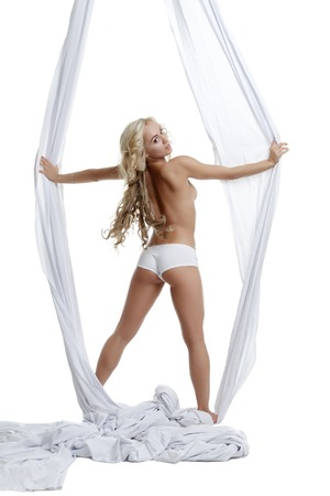 topless: Image of alluring topless blonde posing with aerial silk