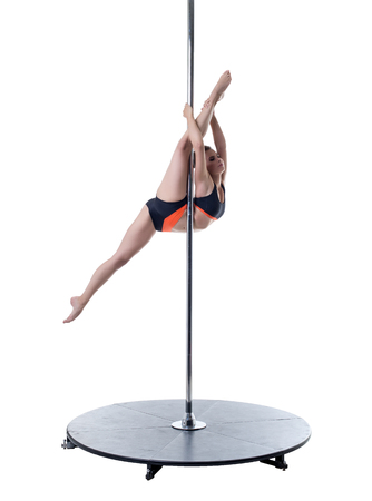 harmonous: Beauty and strength. Image of pretty girl dancing on pylon Stock Photo