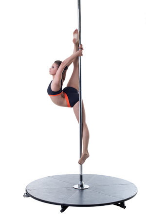 harmonous: Strength and grace of pole dance. Cute girl doing vertical split